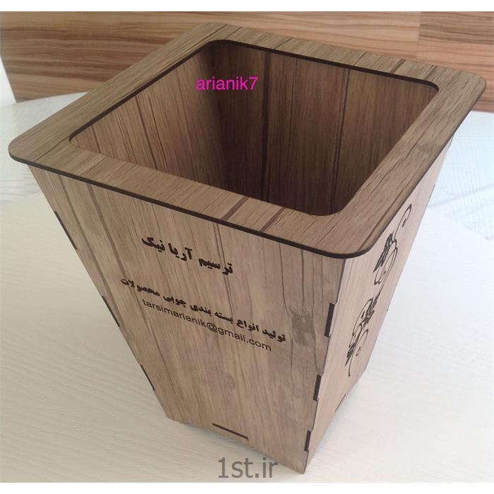 عکس سایر لوازم خانگیسطل زباله چوبی طرح دار