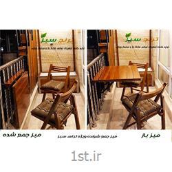 عکس ست میز و صندلی باغمیز تاشو و کم جا مناسب تراس سبز