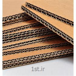عکس انبار محصولات بسته بندیکارتن با منقسم 3 لا و 5 لا
