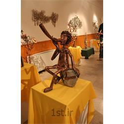 عکس صنایع دستی فلزیمجسمه فلزی تزئینی مدل شیپورزن