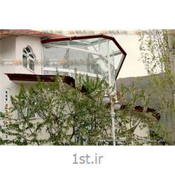 عکس خانه شیشه ایبالکن شیشه ای مهر (پارتیشن شیشهای متحرک مدل آکاردئونی با چهار شکستگی در مسیر)
