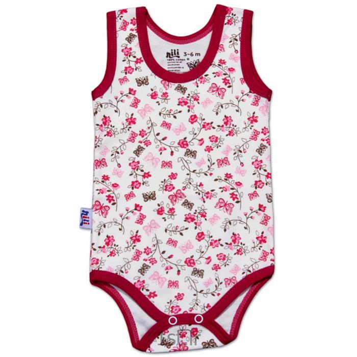 عکس پیراهن نوزادلباس نوزاد نیلی زیردکمه رکابی طرح گل و پروانه