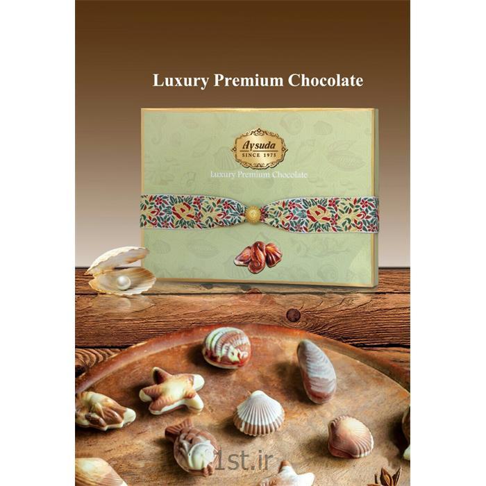 عکس انبار محصولات بسته بندیجعبه شکلات کادویی مستطیلی هاردباکس طرح سفارشی  ابعاد 24.5*34.5 سانت